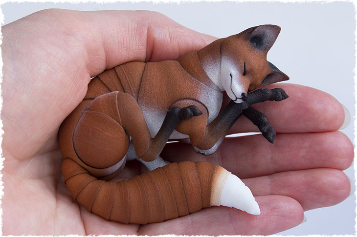 BJD adult red fox is sleeping on the hand
